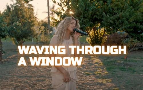 Tori Kelly Waving Through A Window